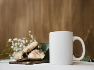 coffee with croissants blurred flowers background 23 2147658673